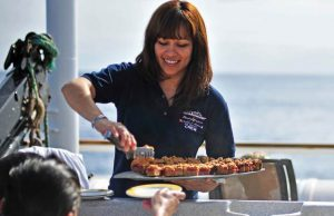 Hostess Sylvia serves treats to guests in the hot tub